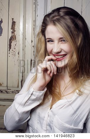 young pretty blond teenage happy smiling girl close up portrait, lifestyle real people concept