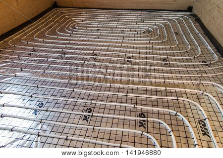 underfloor heating pipes spread on polystyrene covered with foil before pouring concrete