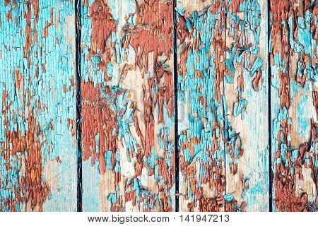 Boards with old paint chips. Background of boards. Painting blue and brown.