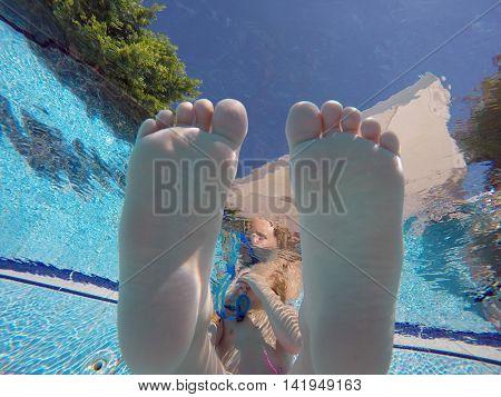 baby foot under water