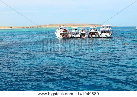 HURGHADA EGYPT - DECEMBER 6: Snorkeling tourists and motor yachts on Red Sea. It is popular tourists destination on December 6 2012 in Hurghada Egypt