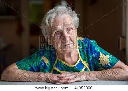 Portrait of an elderly woman. Grandma. Retired. Close-up.