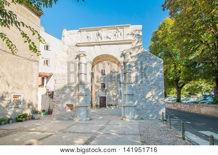 Old gate and street in the old town of Cres, Croatia, Mediterranean ambient