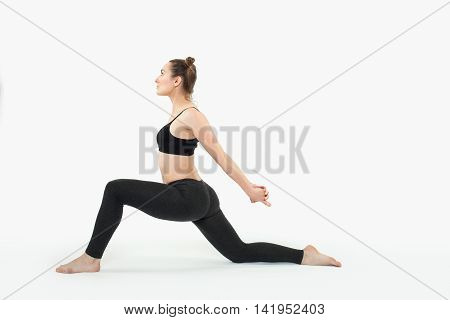 Young brunette woman doing pilates exercises isolated