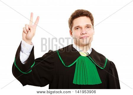 Law court and justice. Man lawyer attorney in polish (Poland) black green gown counting on fingers two isolated on white.