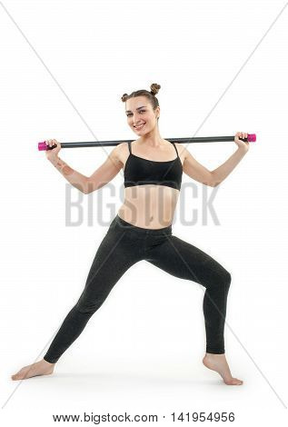 Young Brunette Woman Doing Pilates Exercises With Gymnastic Stick Isolated