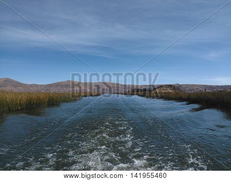 Ripples in the water on the beautiful lake Titicaca outside Puno, Peru