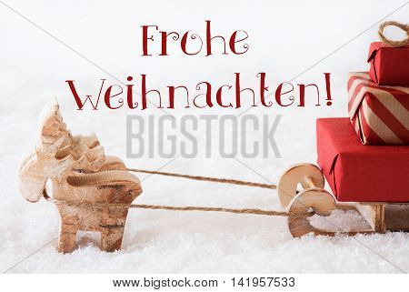 Moose Is Drawing A Sled With Red Gifts Or Presents In Snow. Christmas Card For Seasons Greetings. German Text Frohe Weihnachten Means Merry Christmas