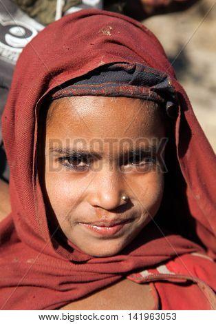 KOLTI VILLAGE WESTERN NEPAL 3rd DECEMBER 2013 - nepalese child head of young girl in western Nepal near Kolti village