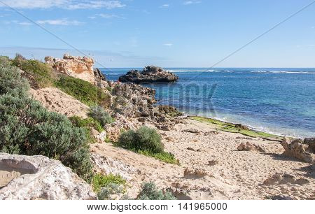 Point Peron with remote beach, coastal limestone and turquoise Indian Ocean seascape under a blue sky in Rockingham, Western Australia