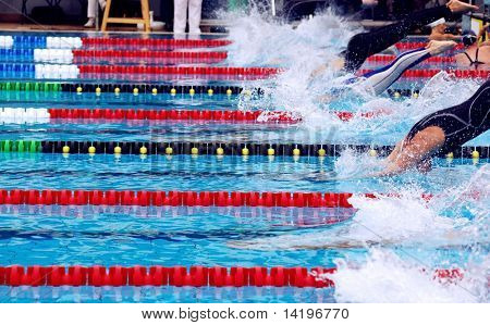 swimming, breaststroke in waterpool with blue water