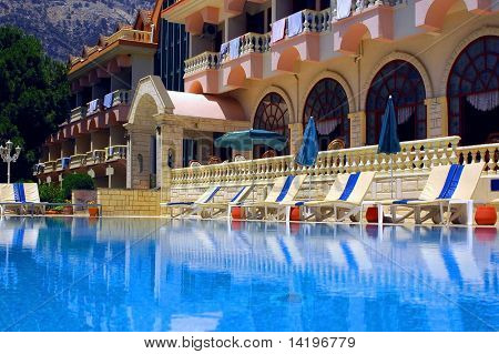 beautiful hotel and waterpool with blue water
