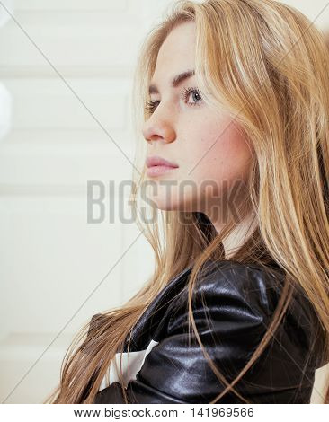 young pretty teenage blond girl sitting on floor at home despair sad alone, lifestyle concept