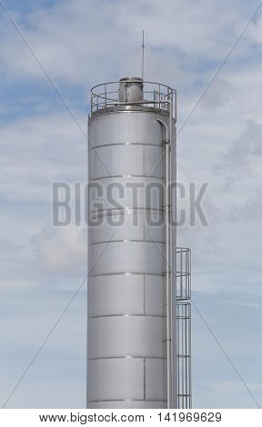Stainless Steel Silo of reserve water for use in industrial factory on blue sky background.