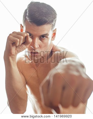 young handsome naked torso man boxing on white background isolated, lifestyle sport people concept close up