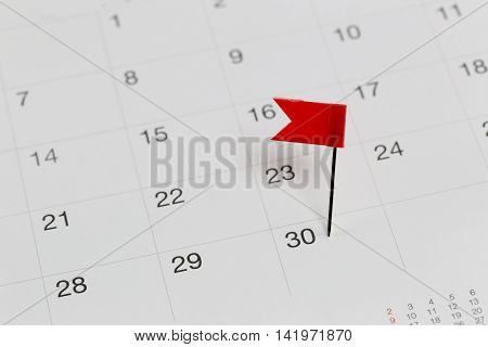 Red Pins to Wildcats on the calendar beside the number end of the month in business concept.