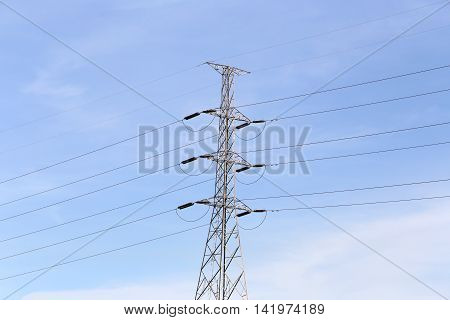 electric pole in the daytime on blue sky background.