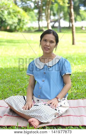 Asian pregnant woman is leisure in the public park and is made brilliant mind because it makes baby good healthy.