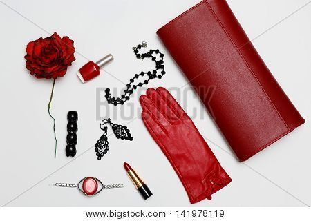 Flat lay feminine red fashion accessories collage on white background.