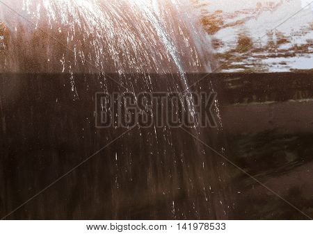 Water flows down the surface of the car during the wash cycle