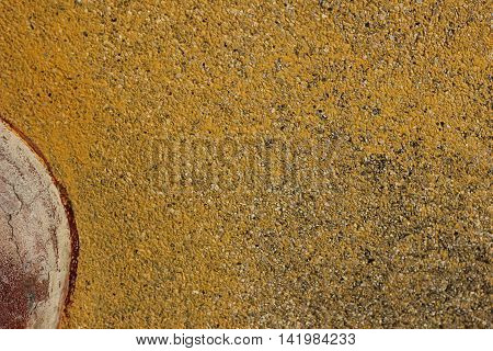 yellow wall with a convex ornament worn sun abstraction