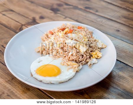 Delicious Noodle With Sunny Up Fried Egg On The Wood Table