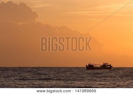 Nautical Fishing Boat In Sea With Beautiful Sky Sunrise In The Morning