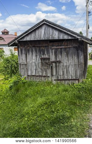 the old grey colored wooden rustic barn