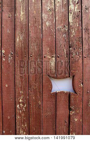 a peeling paint on old wood wall