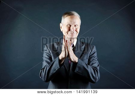 Happy Businessman clapping his hands portrait isolated on black background