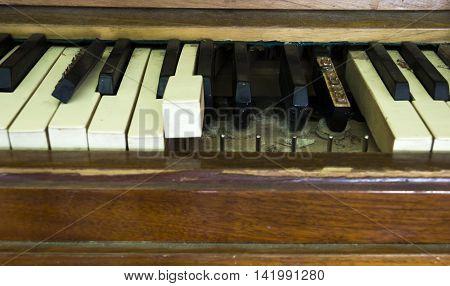 close-up damaged keys of old broken disused piano