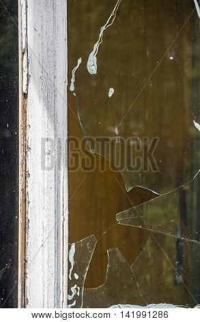 close-up of the old window with broken glass
