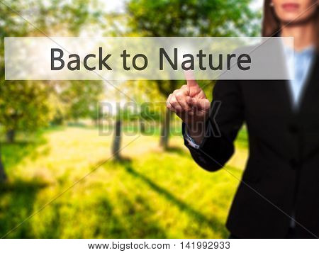 Back To Nature - Businesswoman Hand Pressing Button On Touch Screen Interface.