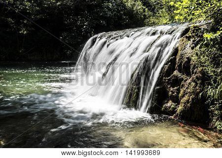 small waterfalls and small lake details closeup