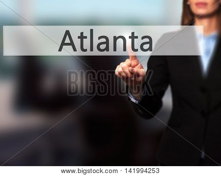 Atlanta - Businesswoman Hand Pressing Button On Touch Screen Interface.