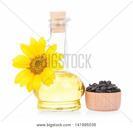 Sunflower oil with flower and seeds isolated over white background
