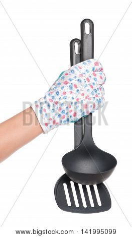 New kitchen utensils in woman hand isolated over white background