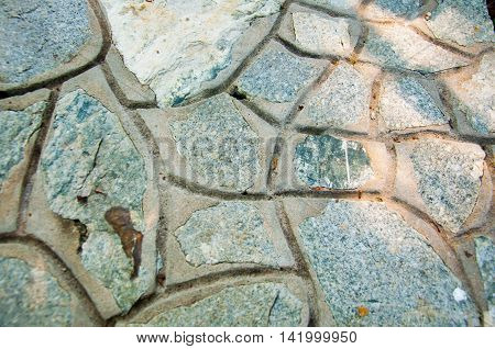 Stone paving texture top view. Abstract structured background