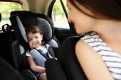 Mother and child in car. Safety driving concept poster