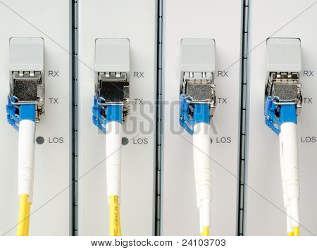 Fiber Optic Cables Connected To An Optic Ports