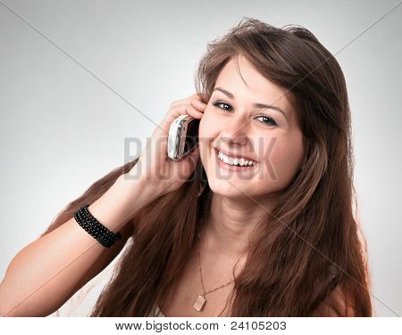 Cute businesslike woman secretary talking on phone