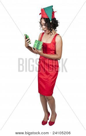 Black Woman Opening A Christmas Ornament
