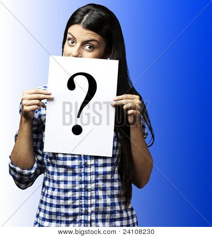 portrait of young woman with question paper on blue background