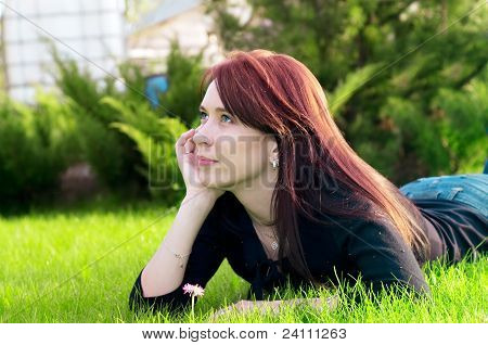 Pretty Woman Lying On Green Grass