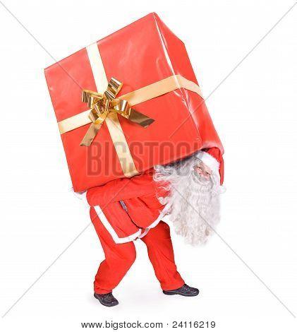 Santa Claus carries a big gift