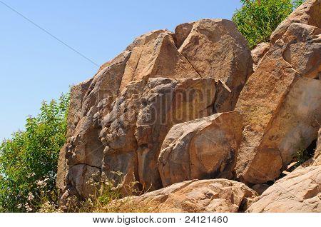 Mountain Rocks In The Summer Sky