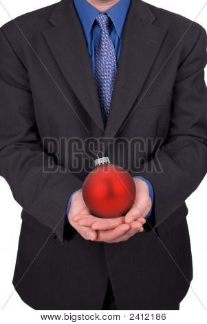 Businessman Holding An Ornament