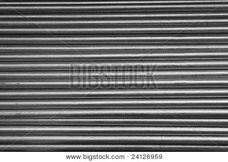 Horizontal pile of small diameter galvanized steel pipe
