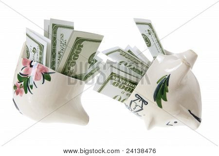Broken Piggy Bank With Dollar Notes