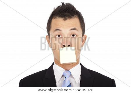 businessman with the post it